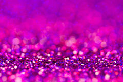 Defocused abstract holidays lights on background. Purple glitter background Royalty Free Stock Photo