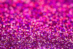 Defocused abstract holidays lights on background. Purple glitter background Stock Photos