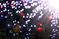 Defocused abstract licht bokeh en de achtergrond van gloedkerstmis Stock Foto