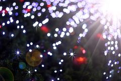 Defocused abstract light bokeh and flare christmas background Stock Photo