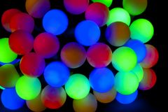 Defocused abstract lights christmas background. Balls royalty free stock image