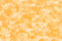 Defocused abstract orange hearts light background Stock Images