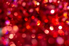 Defocused abstract red christmas background. Happy Merry Christmas and New year. Background blur texture bokeh, violet, yellow, pink, six sides, round. Defocused royalty free stock photo