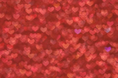 Defocused abstract red hearts light background Royalty Free Stock Photography