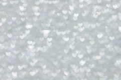 Defocused abstract silver hearts light background Stock Photography