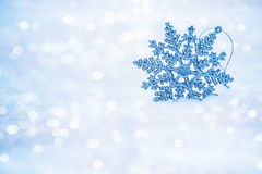 Defocused abstract snowflakes on snow bokeh. Stock Photography