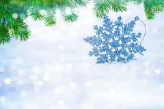 Defocused abstract snowflakes on snow bokeh. stock images