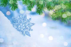 Defocused abstract snowflakes on snow bokeh. stock photos