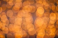 Defocused abstrakt bakgrund för ljusa prickar Suddig bokeh mousserar arkivbilder