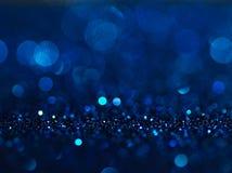 Defocused abstrakt begreppblått tänder bakgrund Bokeh lampor Arkivbilder