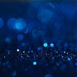 Defocused abstrakt begreppblått tänder bakgrund Bokeh lampor Royaltyfri Fotografi