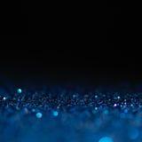 Defocused abstrakt begreppblått tänder bakgrund Bokeh lampor Fotografering för Bildbyråer