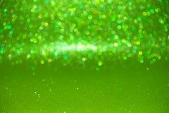 Defocused abstrakt begreppgräsplan blänker med bokehbakgrund Arkivbild