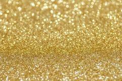 Defocused abstrakt guld- lampabakgrund Arkivbild