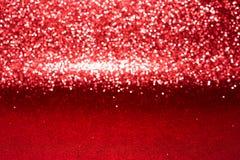 Defocused abstrakt rött blänker med bokehbakgrund Arkivbild