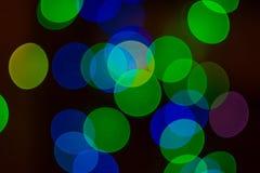 Defocused abstrakta blåa och gröna bokehljus Jul ny Ye fotografering för bildbyråer