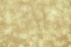 Defocused abstrakter goldener Leuchtehintergrund Stockfotografie