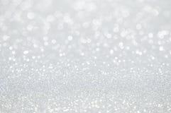 Defocused abstrakter Hintergrund der weißen Lichter Stockfotos