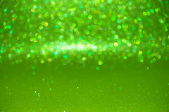 Defocused abstraktes grünes Funkeln mit bokeh Hintergrund Stockfotografie