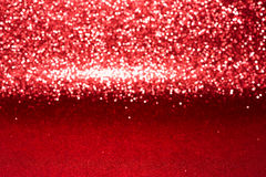 Defocused abstraktes rotes Funkeln mit bokeh Hintergrund Stockfotografie