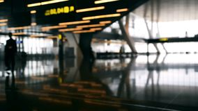 Defocused airport baackground. Silhouette people walking at the airport stock video