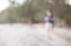 Defocused background , park with walking people Stock Photo