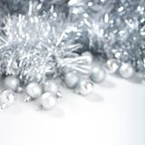 Defocused christmas background with silver christmas balls and tinsel. Square format. Defocused background with silver christmas balls and tinsel stock photo