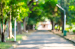 Defocused background of summer park with walking people Stock Images