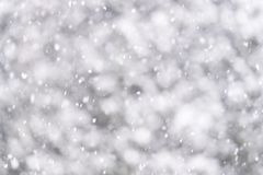 Defocused background of thock soft falling snow. Winter and holiday background Stock Photos