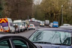 Defocused background with view to road with cars parked all around royalty free stock image