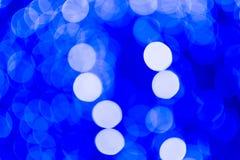 Defocused bakgrund för abstrakt begreppblåttjul abstrakt lampor Royaltyfri Foto