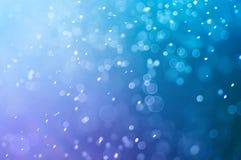 Defocused bakgrund för abstrakt blå bokeh Arkivfoto