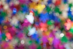 Defocused barwiąca gwiazdowa błyskotliwość zaświeca tło zamazany fotografia royalty free