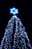 Defocused big outdoors christmas tree Royalty Free Stock Image