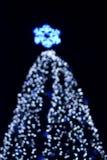 Defocused big outdoors christmas tree royalty free stock image