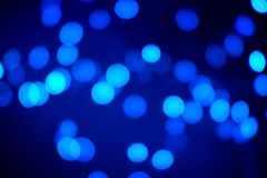 Black and Blue Abstract Bokeh Background royalty free stock photography
