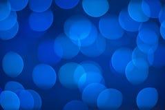 Defocused blaue Leuchten. stockbilder