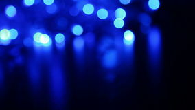 Defocused blue lights with bokeh, blurred motion abstract backgrounds Royalty Free Stock Images