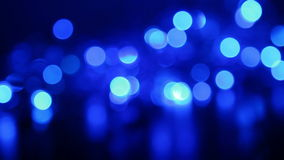 Defocused blue lights with bokeh, blurred motion abstract backgrounds Royalty Free Stock Photo