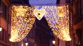 Defocused blur of beautiful christmas decoration above the street with large curtain