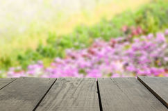 Defocused and blur image of terrace wood and Beautiful flower. Defocused and blur image of terrace wood and Beautiful violet fower field for background usage Stock Image