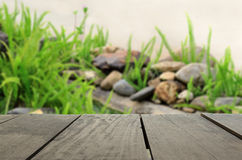 Defocused and blur image of terrace wood and beautiful garden. For background usage Royalty Free Stock Photo