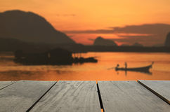 Defocused and blur image of terrace wood and beautiful seascape. Blur image of terrace wood and beautiful seascape and fisherman in morning view for background Royalty Free Stock Photo