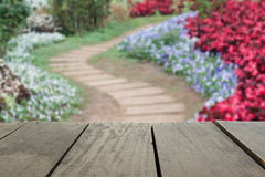 Defocused and blur image of terrace wood and pathway in the park. For background usage Stock Photos