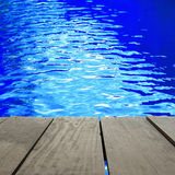 Defocused and blur image of terrace wood and swimming pool for b Stock Photos