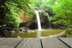 Defocused and blur image of terrace wood and waterfall for backg. Round usage stock photography
