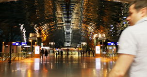 Defocused blur people at modern train station with glass roof stock video footage