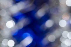 Defocused blurred Christmas lights background Stock Images