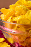 Defocused and blurred macro view of yellow cornflake Royalty Free Stock Photos
