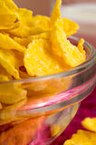 Defocused and blurred macro view of yellow cornflakes Stock Photography